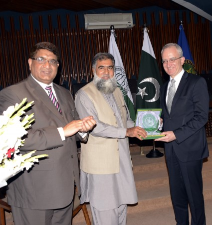 Dr. Masoom Yasinzai. presenting university crest to Mr. Carlos Morales Ambassador of Kingdom of Spain to Pakistan
