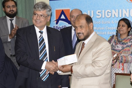 Director Allied Bank presenting 4 Milion to IIUI